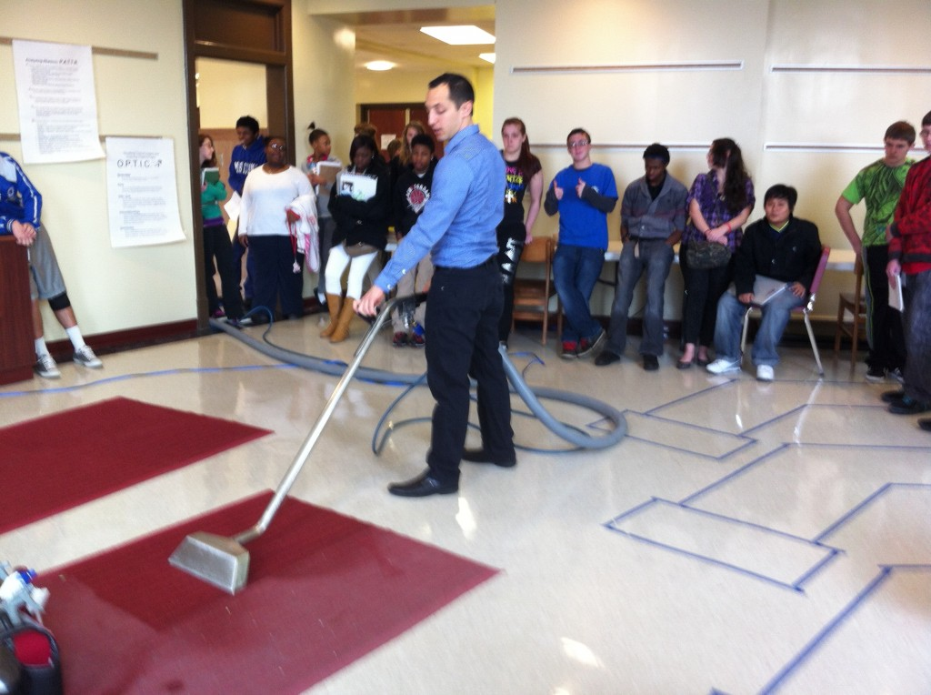 Alan demonstrating cleaning to Northside High School Students 1