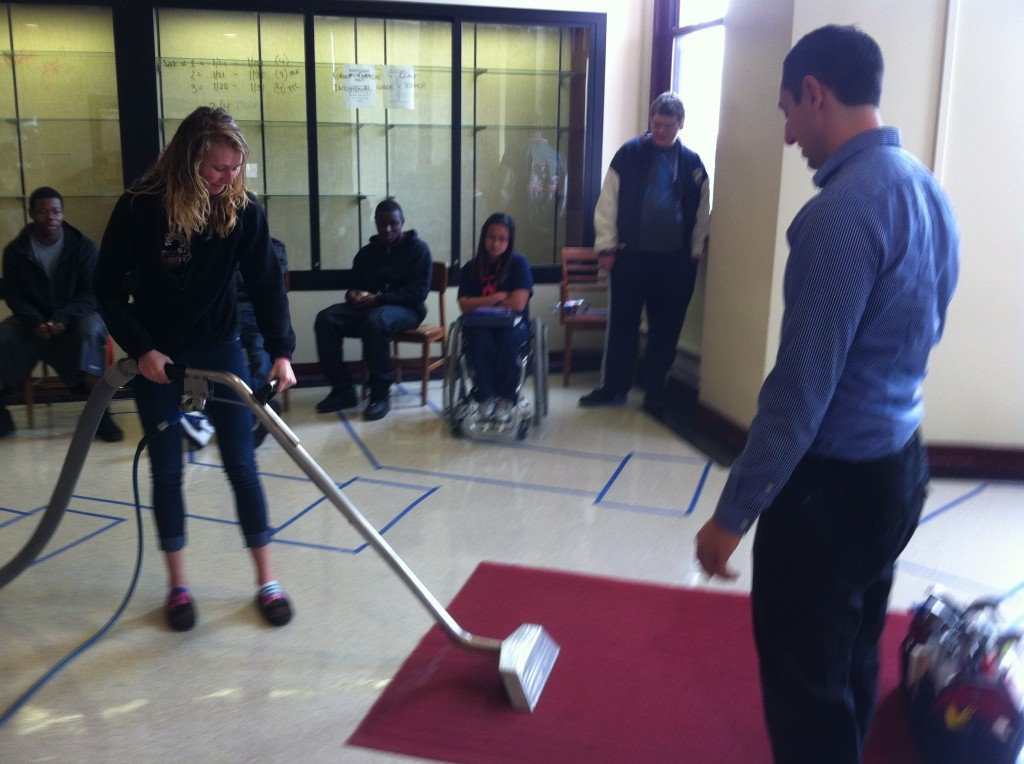 Alan demonstrating cleaning to Northside High School Students 3