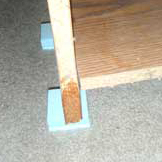 We use blocks to protect wooden furniture from coming into contact with wet surfaces.