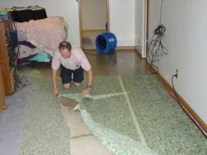 Removing wet carpet pad from flooded basement