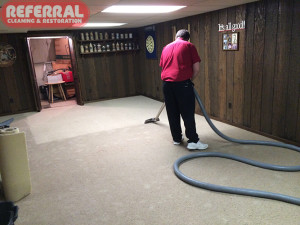 Emergency -  Extracting water from a glue down carpet in a basement in fort wayne