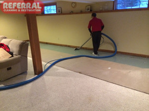 Emergency -  Extracting water from concrete floor after a fort wayne homes basement flooded