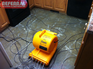 Emergency -  Injecting hot air into cabinet bases to dry after a water damage in a fort wayne home