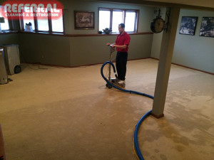 Emergency -  Using Hydro X to extract water from carpet and pad in a Fort Wayne Basement