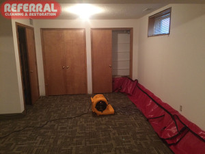 Emergency -  Using hot dry air flow to channel dry a wet basement wall after a water damage